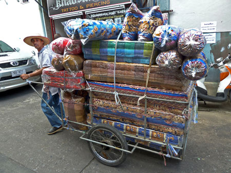 The rarely sighted mattress cart makes its rounds in Banglamphu, Bangkok, Thailand.