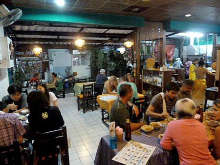 A busy night at May Kaidee's in Banglamphu, Bangkok, Thailand.