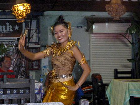 May Kaidee dances the night away at her vegetarian restaurant in Banglamphu, Bangkok, Thailand.