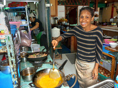 Noi cooks up a replica of the sun at May Kaidee's in Banglamphu, Bangkok, Thailand.