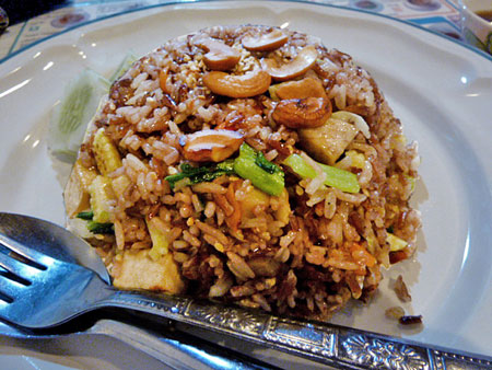 A pile of mushrooms, tofu and rice at May Kaidee's in Banglamphu, Bangkok, Thailand.