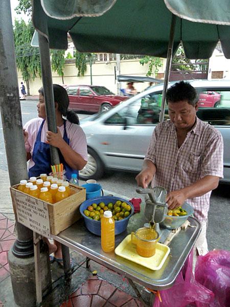 A fresh-squeezed orange juice stand in Banglamphu, Bangkok, Thailand.