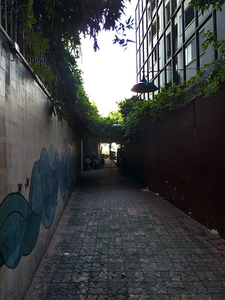 An alley leading to Phra Ahtit pier on the Chao Phraya river in Bangkok, Thailand.