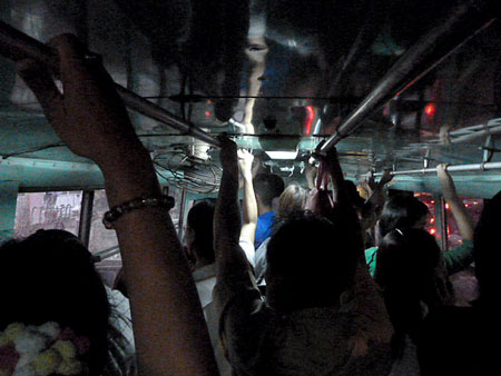 Another packed bus in Bangkok, Thailand.