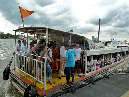 An overloaded river taxi gets ready to sink in Bangkok, Thailand.
