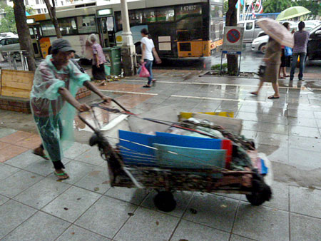 Even more elusive than the broom cart is the spectacular low-slung rubbish cart in Banglamphu, Bangkok, Thailand.