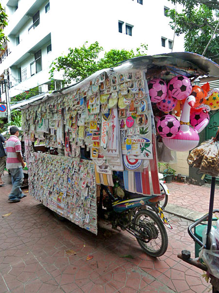 The rarely seen sticker cart caught out in the hot light of day in Banglamphu, Bangkok, Thailand.