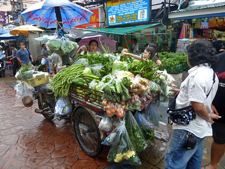 An overloaded vegetable cart on Thanon Khao San in Banglamphu, Bangkok, Thailand.