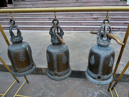 Three little bells at Wat Kanlayanamit in Bangkok, Thailand.