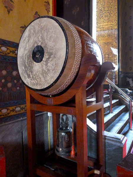 A big-ass drum and its little brother bell at Wat Kanlayanamit in Bangkok, Thailand.