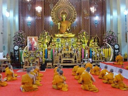 Buddhist monks sing during a prayer service at Wat Chana Songkhram in Banglamphu, Bangkok, Thailand.