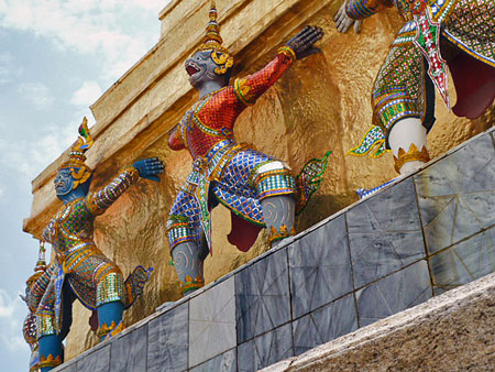 These guys have a heavy load to bear at the Temple of the Emerald Buddha compound in Bangkok, Thailand.