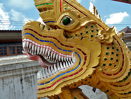 Close-up of a guard dragon in front of one of the insanely nice-looking temples at Wat Kuan Kama in Chiang Mai, Thailand.