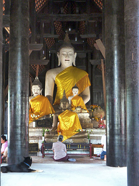 Four Buddhas preside over an unknown wat in Chiang Mai, Thailand.