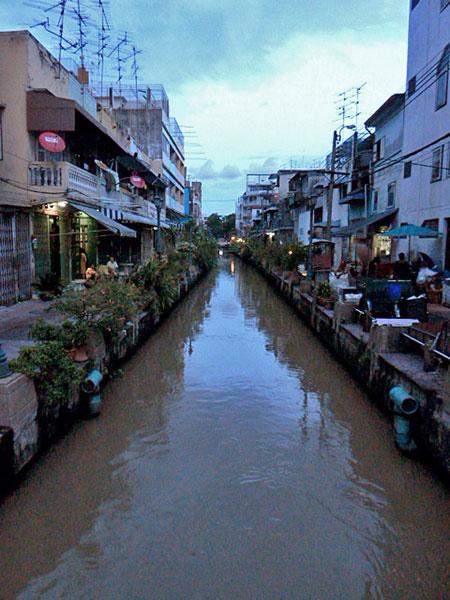 A canal at dusk in Bangkok, Thailand.