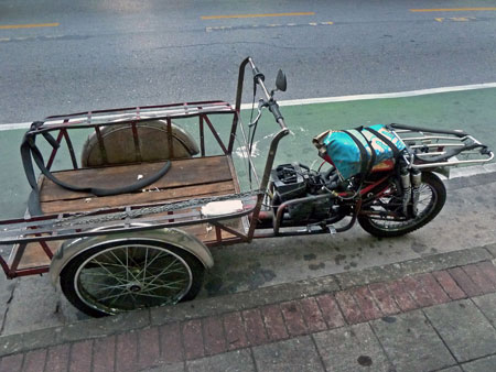 A low-slung tricycle cart in Bangkok, Thailand.