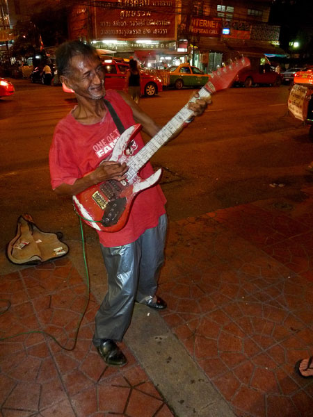 Uddy busts out with a little busk 'n' roll near Thanon Khao San in Bangkok, Thailand.