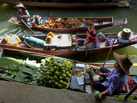 A cornucopia of colorful food at the floating market in Damnoen Saduak, Thailand.