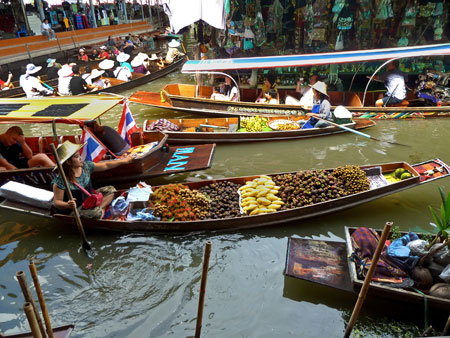 Traffic increases at the floating market in Damnoen Saduak, Thailand.