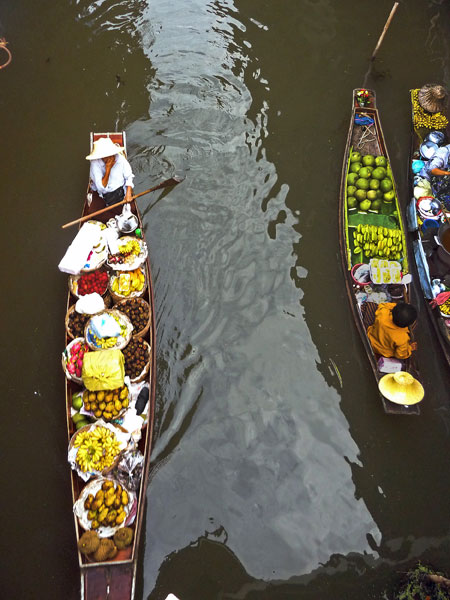 A few more early vendors arrive at the floating market in Damnoen Saduak, Thailand.