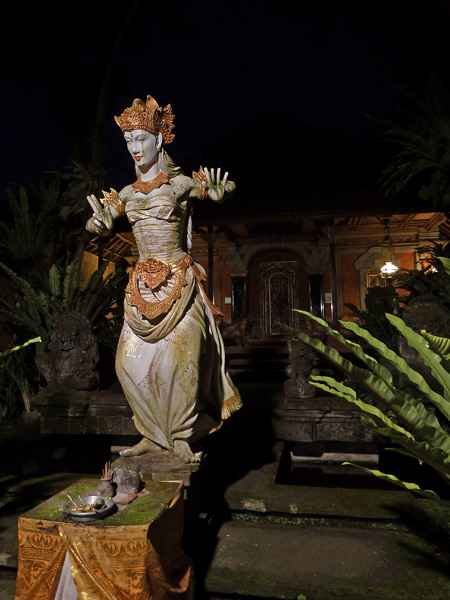 A statue of a traditional Balinese dancer at Ubud Palace in Ubud, Bali, Indonesia.