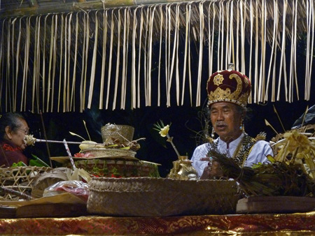 A priest conducts a ritual the night before the royal cremation ceremony at Ubud Palace in Ubud, Bali, Indonesia.