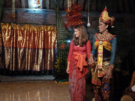 Katia takes part in the comedy section of a Calon Arang performance at a Hindu temple ceremony in Bangli, Bali, Indonesia.
