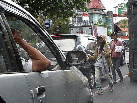 Street sellers ply their trade in Denpasar, Bali, Indonesia.