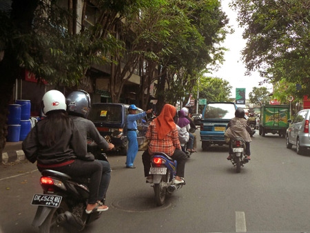 Hectic maneuvers at speed in Denpasar, Bali, Indonesia.