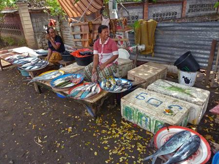Ladies selling fish on the roadside near the beach in Lovina, Bali, Indonesia.