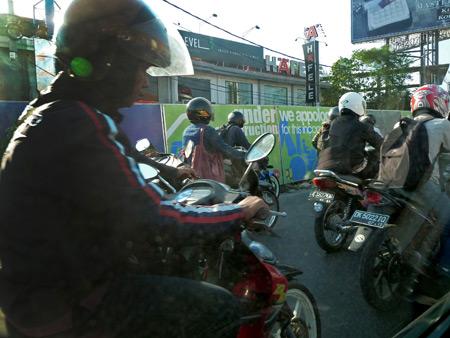 Standard motorcycle chaos in Denpasar, Bali, Indonesia.