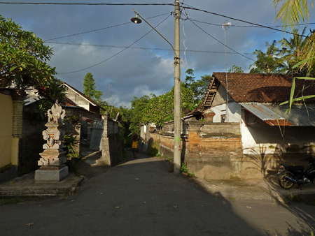 A back alley intersection at sunset in Peliatan, Bali, Indonesia.