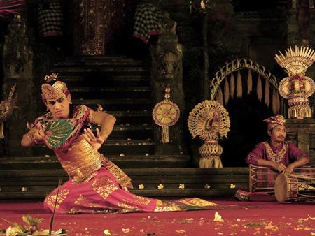 Chandra Wirabhuana performs the Kebyar Duduk dance at the Lotus Pond in Ubud, Bali, Indonesia.