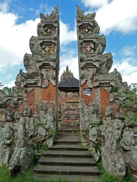 A temple gate in a rice field in Ubud, Bali, Indonesia.