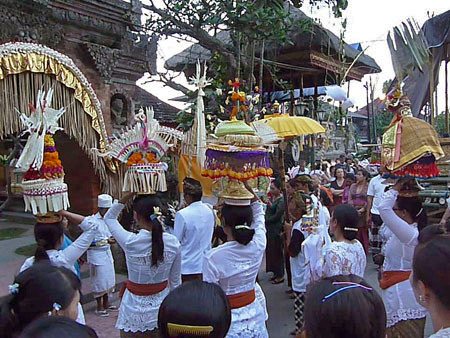 A temple procession prepares to enter Ubud Palace in Ubud, Bali, Indonesia.
