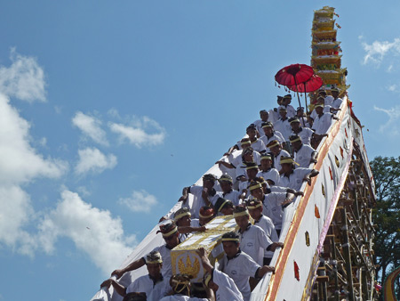 A casket containing the body of Tjokorda Putra Di Armayudha is lowered from the tower during the royal cremation ceremony at Pura Dalem Puri in Ubud, Bali, Indonesia.