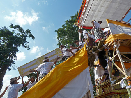 A casket containing the body of Tjokorda Putra Di Armayudha is carried up to the bull during the royal cremation ceremony at Pura Dalem Puri in Ubud, Bali, Indonesia.