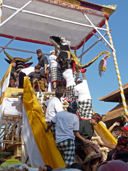 The top of the bull is put back on during the royal cremation ceremony at Pura Dalem Puri in Ubud, Bali, Indonesia.
