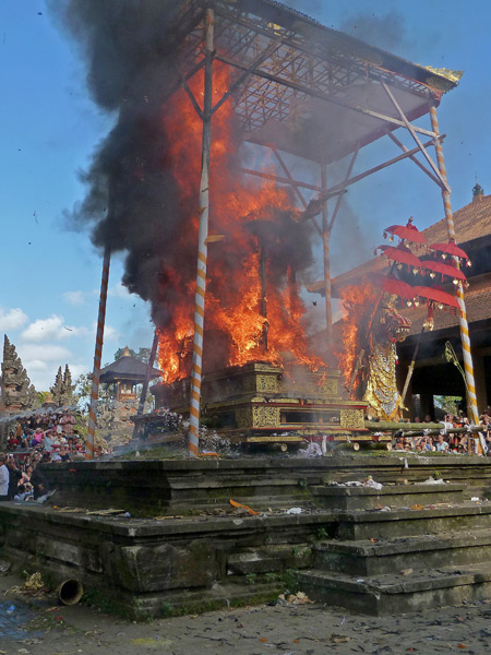 The bull containing the body of Tjokorda Putra Di Armayudha burns brightly during the royal cremation ceremony at Pura Dalem Puri in Ubud, Bali, Indonesia.