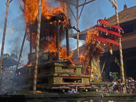 The bull containing the body of Tjokorda Putra Di Armayudha burns brightly alongside the dragon during the royal cremation ceremony at Pura Dalem Puri in Ubud, Bali, Indonesia.