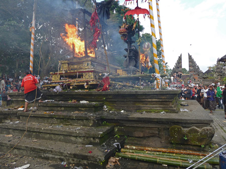 The body of Tjokorda Putra Di Armayudha keeps on a-burning during the royal cremation ceremony at Pura Dalem Puri in Ubud, Bali, Indonesia.