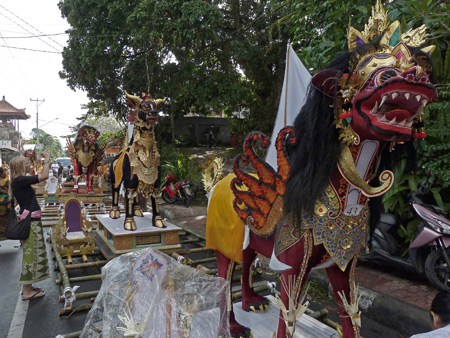 A fierce dragon / lion / horse hybrid with wings rules the staging area of the royal cremation ceremony in Ubud, Bali, Indonesia.