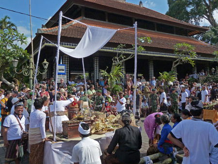 Two priests conduct a ritual during the royal cremation ceremony in Ubud, Bali, Indonesia.
