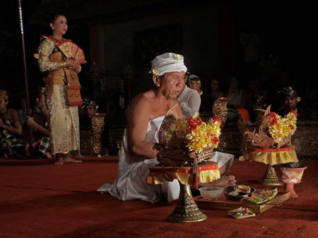 Sekehe Gong Panca Artha performs the Legong Trance dance at Ubud Palace in Ubud, Bali, Indonesia.