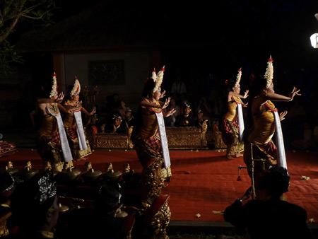 Sekehe Gong Panca Artha performs the Sisya dance at Ubud Palace in Ubud, Bali, Indonesia.
