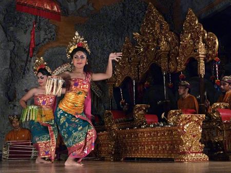 Sanggar Suwara Guni Kanti performs the Pendet dance at Bale Banjar Ubud Kelod in Ubud, Bali, Indonesia.