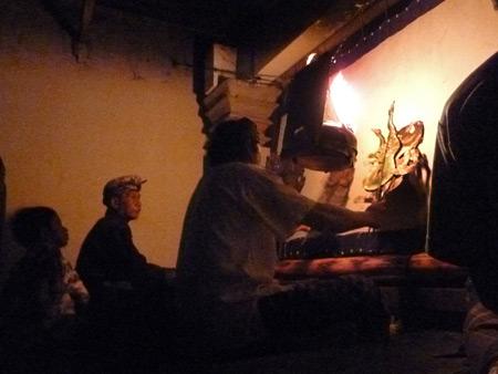 The Dalang (puppet master) performs Wayang Kulit at Oka Kartini in Ubud, Bali, Indonesia.