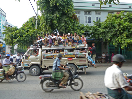 The cast of Hee-Haw barnstorms through the streets of Mandalay, Myanmar.