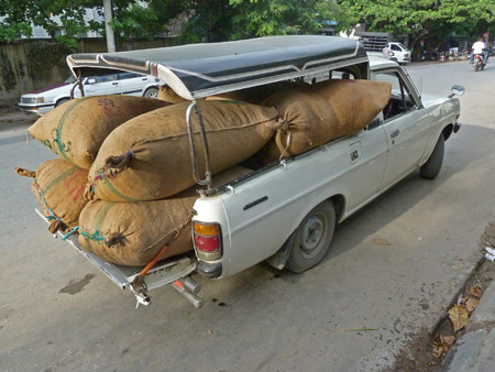 Do you need anything from the feed store? A loaded down truck in Mandalay, Myanmar.