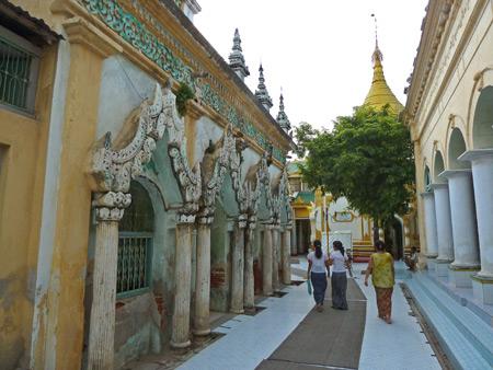Walking between temples at Shwekyimyint in Mandalay, Myanmar.